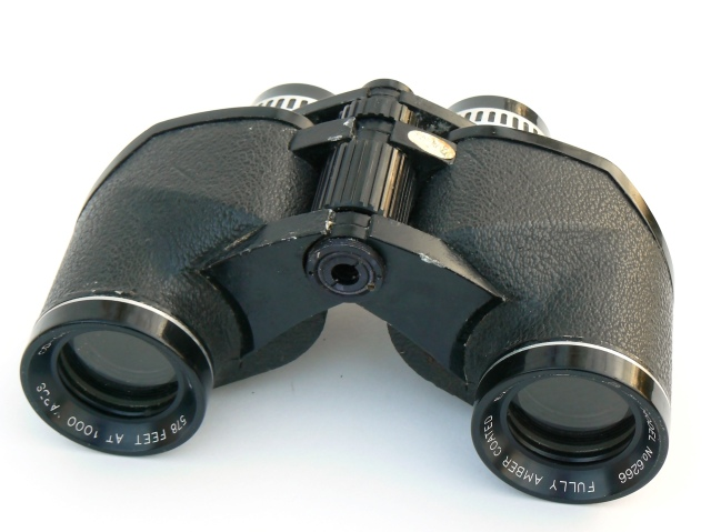 Binoculars on a white background.